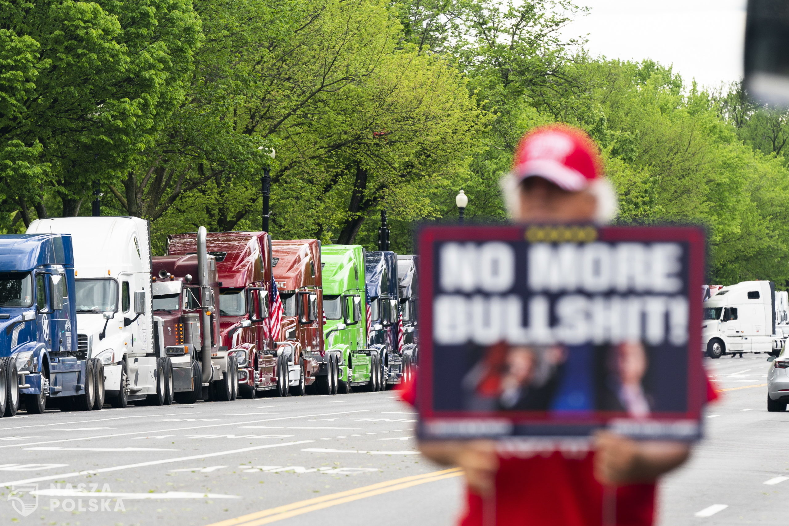 Truckers gather on Constitution Avenue for a May Day protest to highlight their complaints that brokers are taking advantage of the coronavirus COVID-19 pandemic to cut trucker pay in Washington, DC USA, 01 May 2020. They also protested lack of access to gloves and face masks during the pandemic.  (EPA/JIM LO SCALZO)